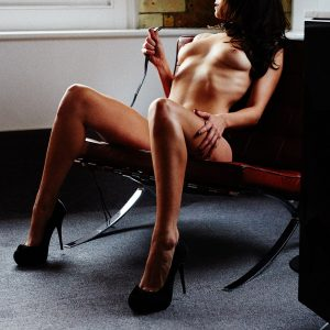 Submissive escort Louisa Knight naked in collar and leash