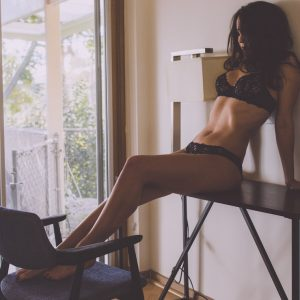 Kinky london escort Louisa Knight reclines in black lace lingerie