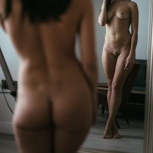 Kinky submissive Louisa Knight naked in front of a mirror