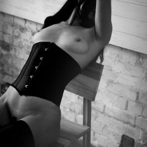 Kinky escort louisa Knight reclines in a corset