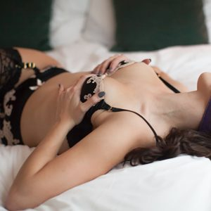 Kinky companion Louisa Knight in lingerie and a ball gag