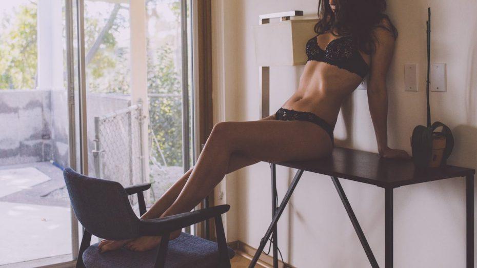 Kinky london escort Louisa Knight reclines in black lace lingerie