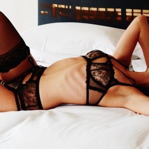 London-based BDSM escort Louisa Knight is blindfolded on a bed