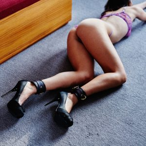 Kinky london escort Louisa Knight poses in purple lingerie and ankle cuffs
