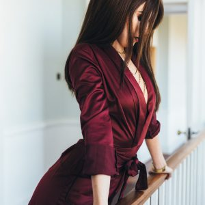 London independent escort Louisa Knight in short dress and high heels.