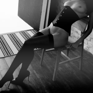 Kinky escort louisa Knight in a corset and stockings