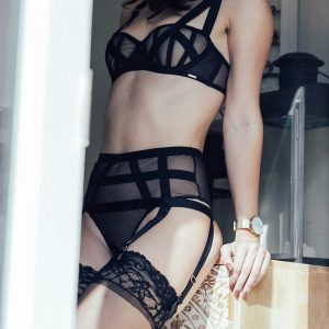 Kinky independent escort Louisa Knight poses in black mesh lingerie
